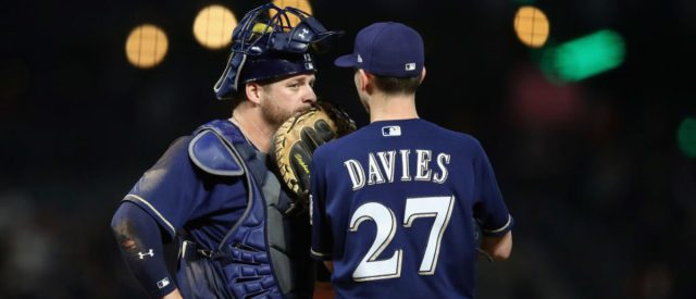 SAN FRANCISCO, CA - AUGUST 21: Stephen Vogt #12 talks to starting pitcher Zach Davies #27 of the Milwaukee Brewers during their game against the San Francisco Giants at AT&T Park on August 21, 2017 in San Francisco, California.  (Photo by Ezra Shaw/Getty Images)
