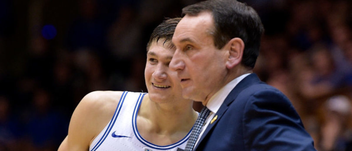 DURHAM, NC - FEBRUARY 14:  Grayson Allen #3 talks to head coach Mike Krzyzewski of the Duke Blue Devils during their game against the Virginia Tech Hokies at Cameron Indoor Stadium on February 14, 2018 in Durham, North Carolina. Duke won 74-52.  (Photo by Grant Halverson/Getty Images)