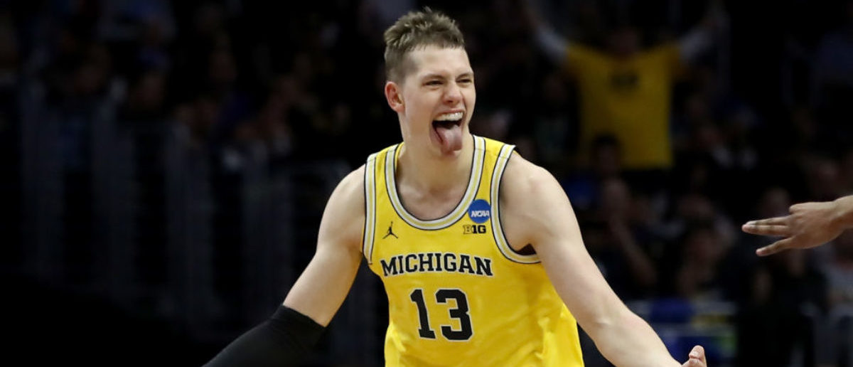 LOS ANGELES, CA - MARCH 22:  Moritz Wagner #13 of the Michigan Wolverines celebrates after Wagner makes a three-pointer in the first half against the Texas A&M Aggies in the 2018 NCAA Men's Basketball Tournament West Regional at Staples Center on March 22, 2018 in Los Angeles, California.  (Photo by Ezra Shaw/Getty Images)