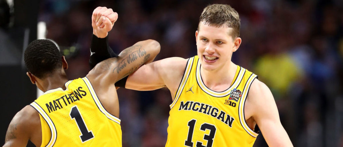 SAN ANTONIO, TX - MARCH 31:  Moritz Wagner #13 of the Michigan Wolverines reacts with Charles Matthews #1 in the second half against the Loyola Ramblers during the 2018 NCAA Men's Final Four Semifinal at the Alamodome on March 31, 2018 in San Antonio, Texas.  (Photo by Ronald Martinez/Getty Images)