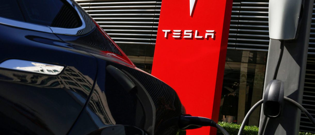 FILE PHOTO:  A Tesla car charges at a charging station in Beijing, China, April 18, 2017.  REUTERS/Thomas Peter