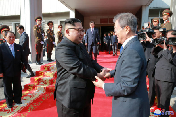 South Korean President Moon Jae-in shakes hands with North Korean leader Kim Jong Un during their summit at the truce village of Panmunjom, North Korea, in this handout picture released by North Korea's Korean Central News Agency (KCNA) on May 27, 2018. KCNA/via REUTERS