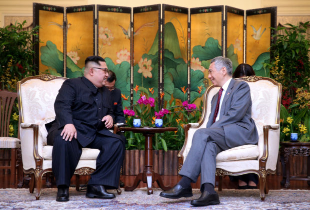 North Korea's leader Kim Jong Un shakes hands with Singapore's Prime Minister Lee Hsien Loong at the Istana in Singapore, June 10, 2018 in this picture obtained from social media. SINGAPORE'S MINISTRY OF COMMUNICATIONS AND INFORMATION/via REUTERS