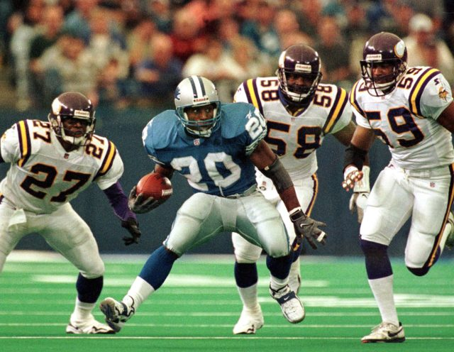 PONTIAC, : Detroit Lions running back Barry Sanders (2ndL) tries to outrun Minnesota Vikings defenders Corey Fuller (L), Ed McDaniel (2ndR) and Dixon Edwards (R) during the fourth quarter of their 25 October game at the Silverdome in Pontiac, Michigan. The Vikings beat the Lions 34-13. (Photo credit should read JEFF KOWALSKY/AFP/Getty Images)