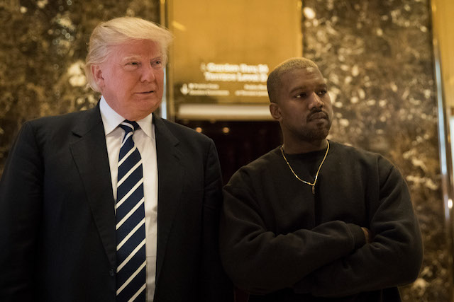 President-elect Donald Trump and Kanye West stand together in the lobby at Trump Tower, December 13, 2016 in New York City. President-elect Donald Trump and his transition team are in the process of filling cabinet and other high level positions for the new administration. (Photo by Drew Angerer/Getty Images)