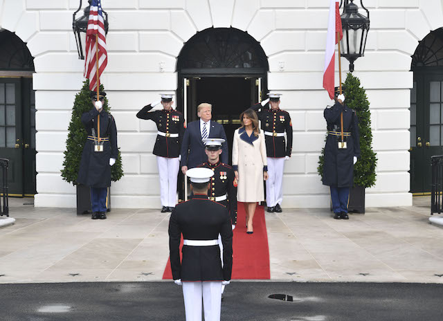 US President Donald Trump and First Lady Melania Trump wait for the arrival of Polish President Andrzej Duda and his wife Agata Kornhauser-Duda to the White House on September 18, 2018 in Washington,DC. (Photo credit: NICHOLAS KAMM/AFP/Getty Images)