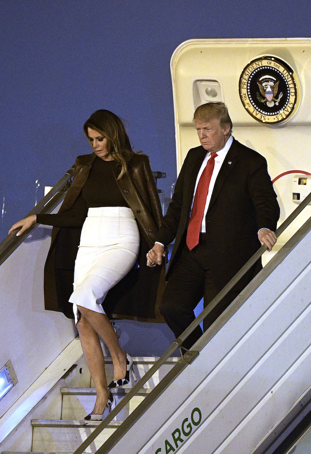 US President Donald Trump (R) and US First Lady Melania Trump, disembark from Air Force One upon arrival at Ezeiza International airport in Buenos Aires province, on November 29, 2018, on the eve of the G20 Leaders' Summit. - US President Donald Trump jets into Argentina on Thursday for a G20 summit, keen to do battle with China on trade and sharpening his rhetoric against Russia over Ukraine. (Photo credit: JUAN MABROMATA/AFP/Getty Images)