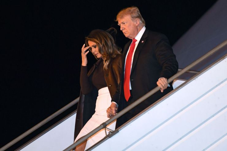 US President Donald Trump and First Lady Melania Trump disembark from Air Force One upon arrival in Buenos Aires, Argentina, on November 29, 2018, as they travel to attend the G20 summit. - US President Donald Trump jets into Argentina on Thursday for a G20 summit, keen to do battle with China on trade and sharpening his rhetoric against Russia over Ukraine. (Photo credit: LOEB/AFP/Getty Images)