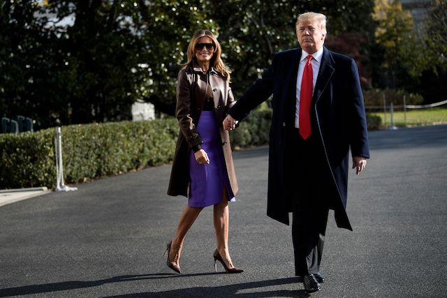 US First Lady Melania Trump and US President Donald Trump walk to Marine One on the South Lawn of the White House November 29, 2018 in Washington, DC. - Trump said Thursday a weekend G20 summit of world leaders would be a