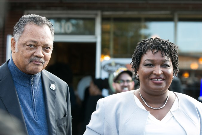 Rev. Jesse Jackson stands with Democratic Gubernatorial candidate Stacey Abrams outside the Busy Bee Cafe on November 6, 2018 in Atlanta, Georgia. (Jessica McGowan/Getty Images)