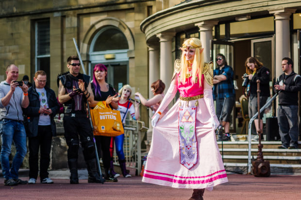 Scarborough, UK - April 08, 2017: Cosplayer dressed as 'Princess Zelda' from the 'Legend of Zelda' video games poses during a cosplay competition at Sci-Fi Scarborough.