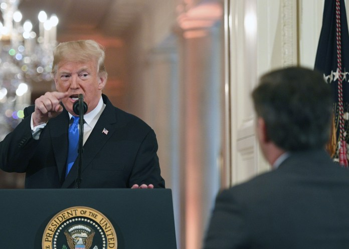 TOPSHOT - US President Donald Trump points to journalist Jim Acosta from CNN during a post-election press conference in the East Room of the White House in Washington, DC on November 7, 2018. (Photo by JIM WATSON/AFP/Getty Images)