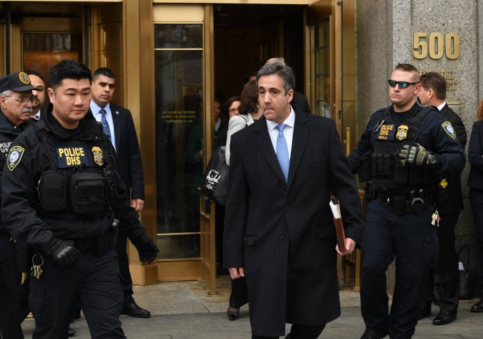 "US President Donald Trumps former attorney Michael Cohen leaves US Federal Court in New York on December 12, 2018 after his sentencing after pleading guilty to tax evasion, making false statements to a financial institution, illegal campaign contributions, and making false statements to Congress. - US President Donald Trump's former lawyer Michael Cohen delivered a blistering attack on his former boss as he was sentenced to three years in prison on December 12, 2018 for multiple crimes. ""It was my duty to cover up his dirty deeds,"" Cohen said as he pleaded for leniency before US District Judge William H. Pauley III.Cohen, 52, said he was taking responsiblity for his crimes ""including those implicating the President of the United States of America."" (Photo by TIMOTHY A. CLARY/AFP/Getty Images)"