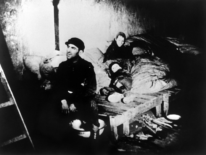 A CAF (Comite anti-fasciste) file picture dated 1943 shows a family in a house in the Warsaw Jewish ghetto during World War II. (Photo credit /AFP/Getty Images)