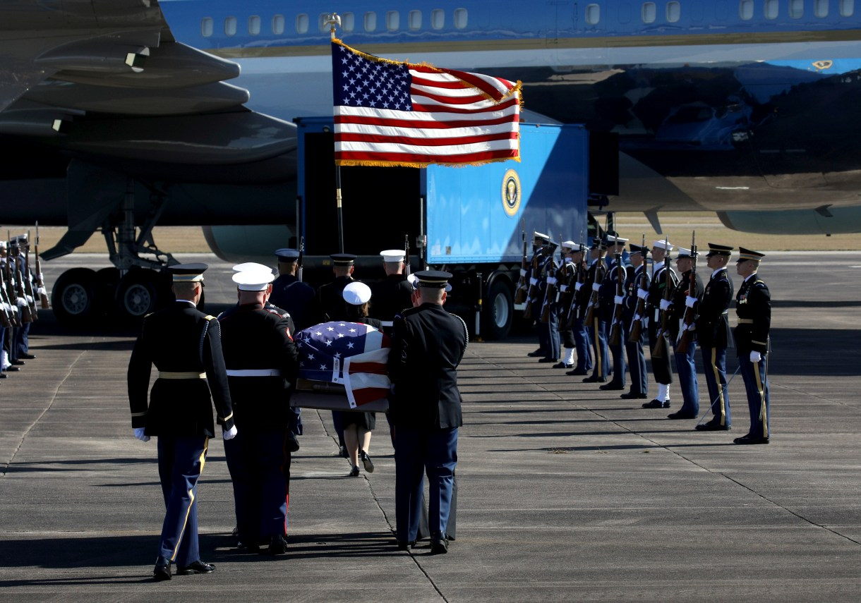Former President George H.W. Bush's casket is carried to the Special Air Mission 41 plane during a departure ceremony at Ellington Field Joint Reserve Base in Houston, Texas, U.S., December 3, 2018. (REUTERS/Loren Elliott)