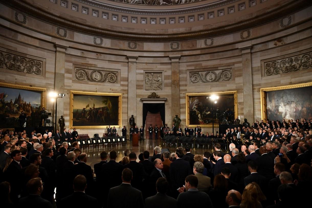 Attendees wait for the casket of former U.S. President George H.W. Bush to arrive at the U.S. Capitol in Washington, D.C., U.S., December 3, 2018. (Brendan Smialowski/Pool via REUTERS)