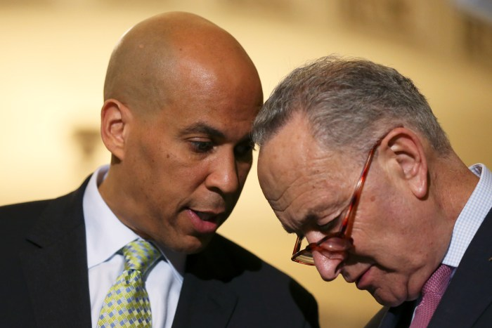 Senator Schumer confers with Booker after Senate Democratic weekly policy lunch on Capitol Hill in Washington