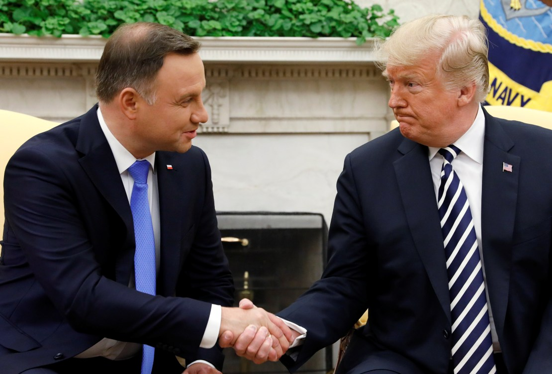 U.S. President Donald Trump greets Poland's President Andrzej Duda in the Oval Office of the White House in Washington, U.S., September 18, 2018. REUTERS/Kevin Lamarque