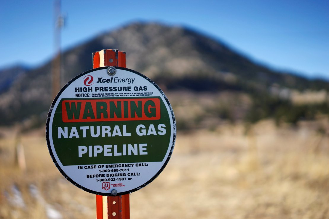 A sign marking the location of a natural gas pipeline is seen in Golden