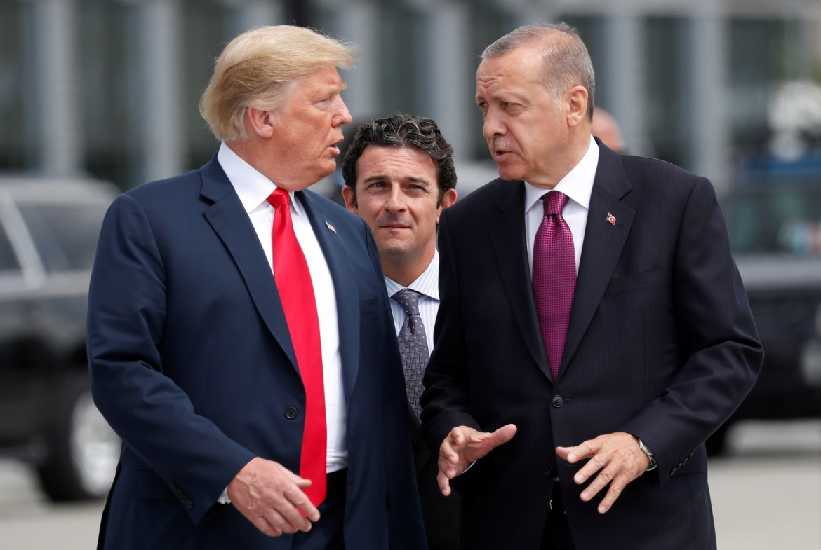 U.S. President Donald Trump and Turkish President Tayyip Erdogan gesture as they talk at the start of the NATO summit in Brussels, Belgium July 11, 2018. REUTERS/Kevin Lamarque