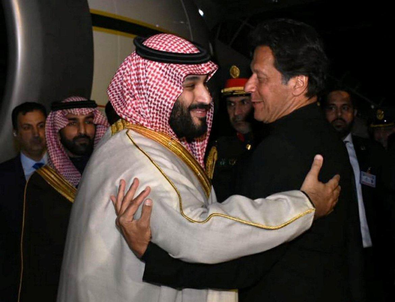 Pakistani Prime Minister Imran Khan (R) greets Saudi Arabia's Crown Prince Mohammed bin Salman on his arrival at Pakistan Air Force (PAF) Nur Khan Base in Rawalpindi, Pakistan February 17, 2019. Press Information Department (PID)/Handout via REUTERS
