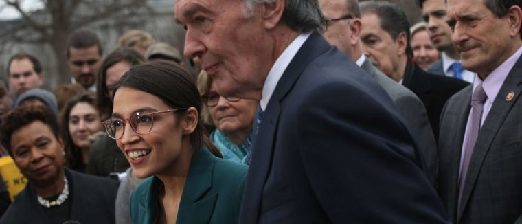 WASHINGTON, DC - FEBRUARY 07: U.S. Rep. Alexandria Ocasio-Cortez (D-NY) speaks as Sen. Ed Markey (D-MA) and other Congressional Democrats listen during a news conference in front of the U.S. Capitol February 7, 2019 in Washington, DC. Sen. Markey and Rep. Ocasio-Cortez held a news conference to unveil their Green New Deal resolution. (Photo by Alex Wong/Getty Images)