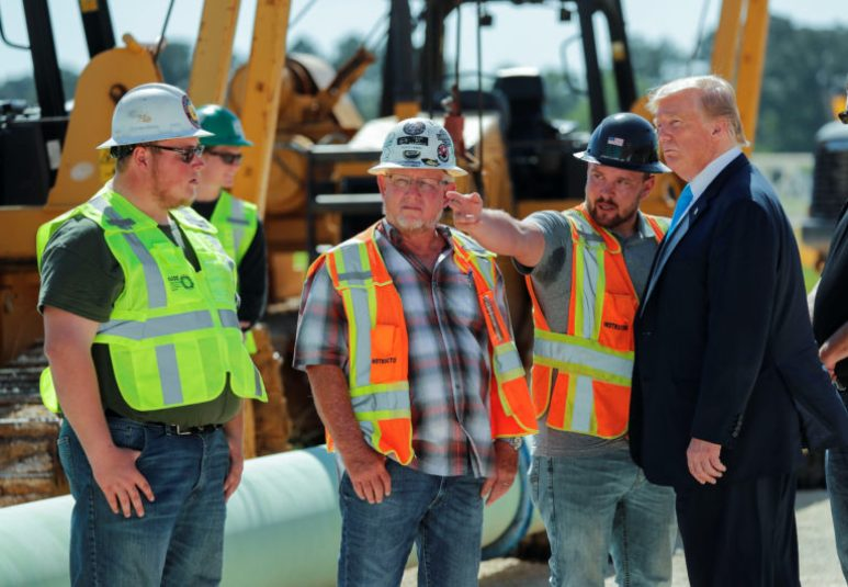 U.S. President Trump talks with workers at the International Union of Operating Engineers International Training and Education Center in Crosby, Texas