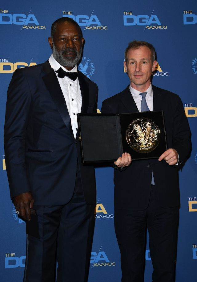 Director Spike Jonze poses next to actor Dennis Haysbert with the award for Outstanding Directorial Achievement in Commercials for