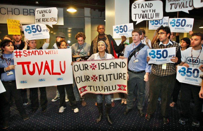 Activists hold a demonstration in support of Tuvalu at the UN Climate Change Conference 2009 in Copenhagen