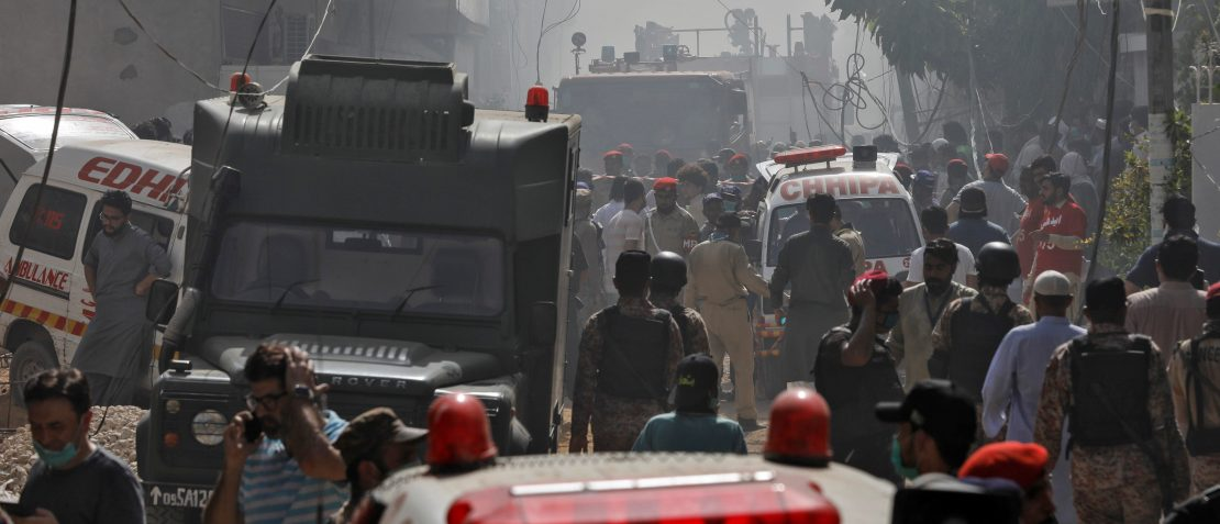 Ambulances and fire brigade vehicles gather at the site of a passenger plane crash in a residential area near an airport in Karachi, Pakistan May 22, 2020. REUTERS/Akhtar Soomro - RC2OTG99R9CC