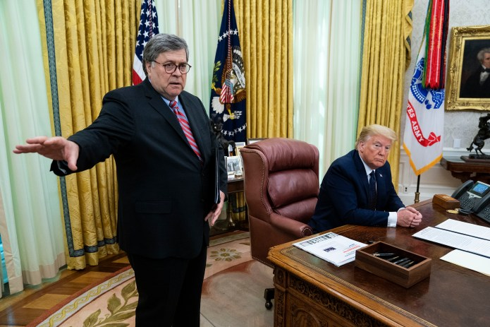 WASHINGTON, DC - MAY 28: U.S. President Donald Trump, with Attorney General William Barr, speaks in the Oval Office before signing an executive order related to regulating social media on May 28, 2020 in Washington, DC. Trump's executive order could lead to attempts to punish companies such as Twitter and Google for attempting to point out factual inconsistencies in social media posts by politicians. (Photo by Doug MIlls-Pool/Getty Images)