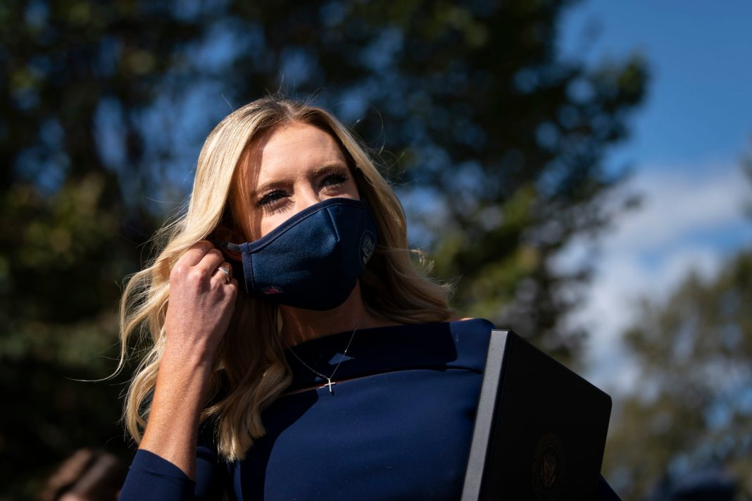 WASHINGTON, DC - OCTOBER 02: White House Press Secretary Kayleigh McEnany arrives to speak with reporters outside the West Wing of the White House on October 2, 2020 in Washington, DC. President Donald Trump and First Lady Melania Trump have both tested positive for coronavirus. (Photo by Drew Angerer/Getty Images)