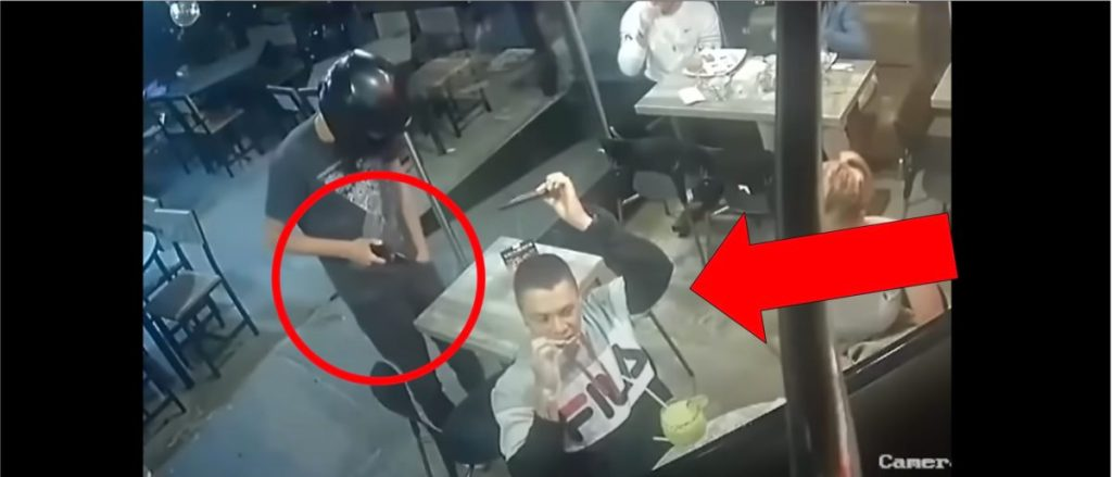 WATCH: Man Eats Chicken Wings While Being Robbed At Gunpoint In Incredible Viral Video