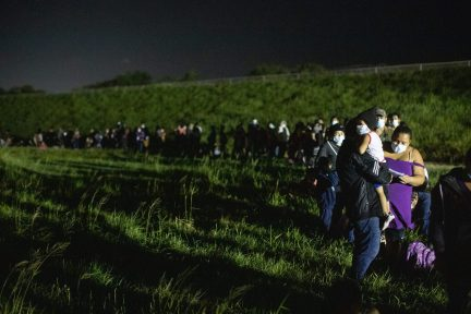 Hundreds of migrants waited in a line to be processed by four Customs and Border Protection agents near the Hidalgo Point of Entry on August 9, 2021. (Kaylee Greenlee - Daily Caller News Foundation