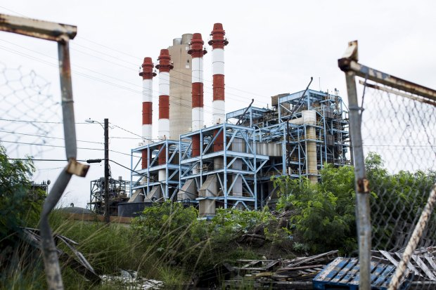 The Puerto Rico Electric Power Authority (PREPA) thermoelectric plant stands San Juan, Puerto Rico, on Saturday, April 30, 2016. Puerto Rico said its Government Development Bank, which is operating in a state of emergency to preserve its dwindling cash, reached an agreement with some credit unions to delay $33 million of bond payments as the commonwealth rushes toward a potential historic default. Photographer: Erika P. Rodriguez/Bloomberg via Getty Images