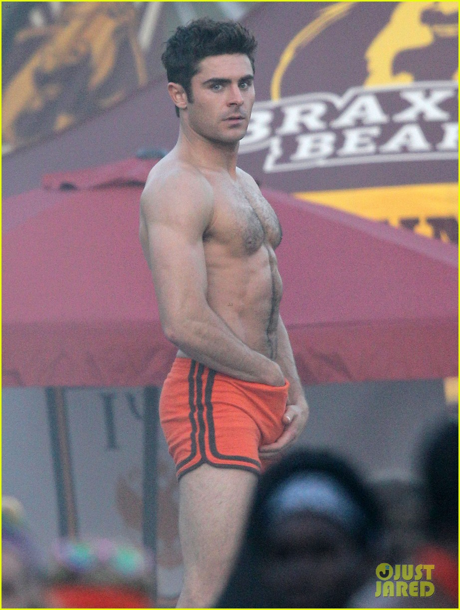 zac efron sticks hand in shorts flaunts eight pack abs 01