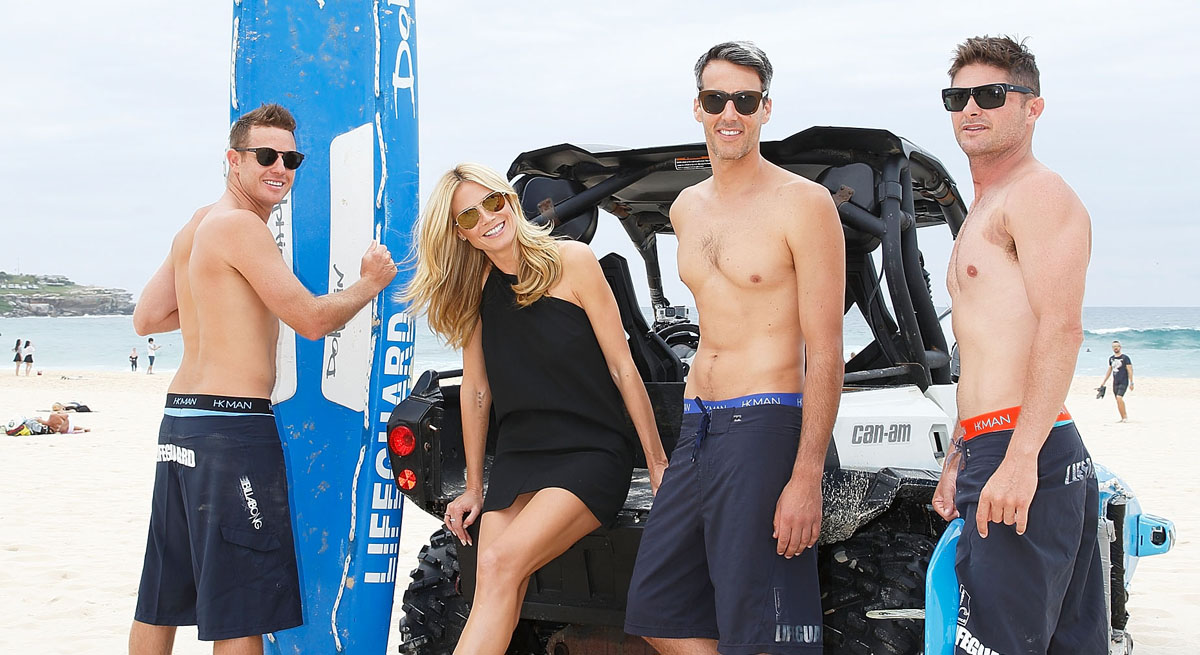 Heidi Klum Poses With Some Shirtless Lifeguards To Promote