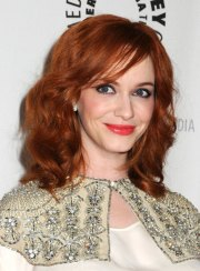 medium red hairstyles with bangs