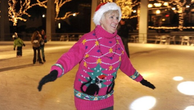 Woman skating with ugly cat sweater