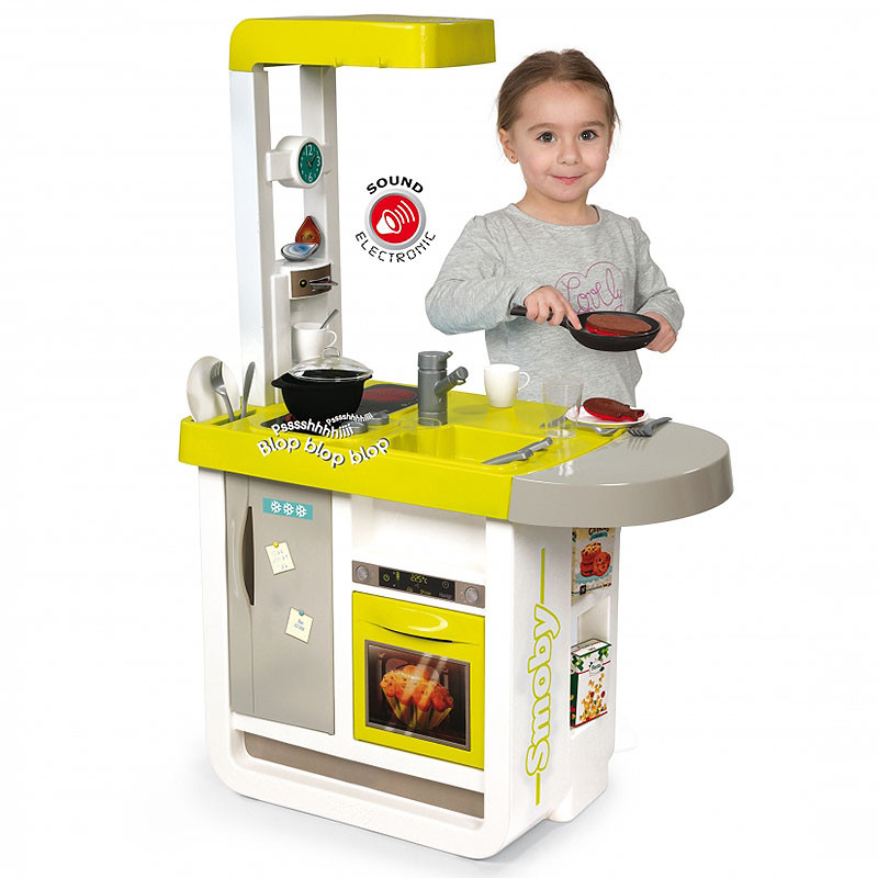 childrens play kitchen coffee themed rugs smoby children s cherry electronic kids 024141 a child playing with frying pan included the from toys