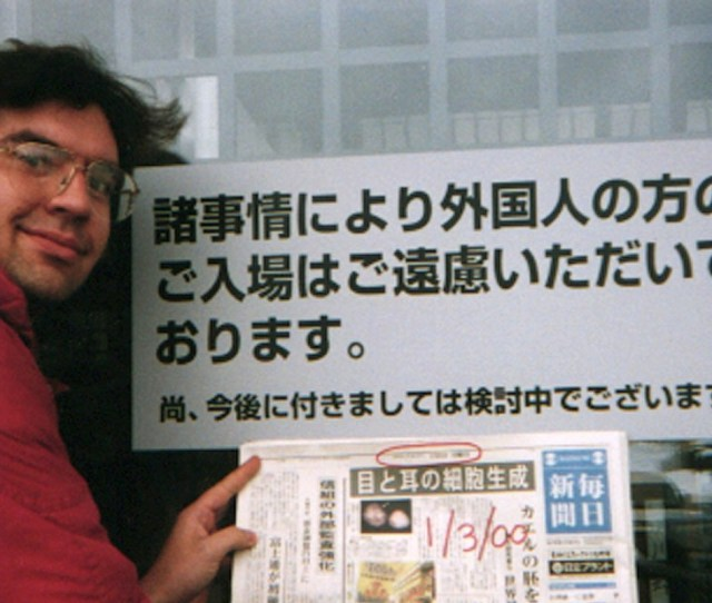 Debito Arudo In Front Of A Japanese Bathhouse With A Sign Saying Japanese Only