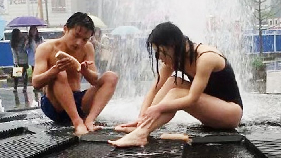 Young Chinese couple ignore security guards to bathe in famed fountain  South China Morning Post