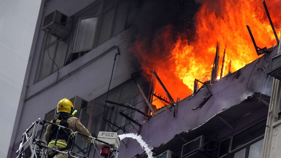 Search under way for cause of thirdalarm fire in Hong Kong residential building  South China