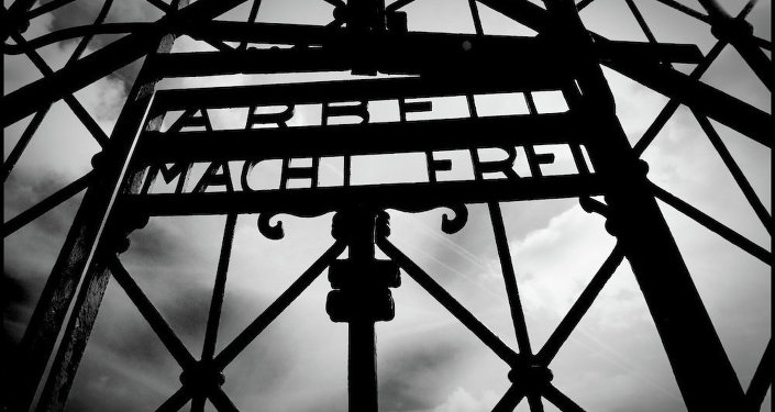 Nazi concentration camp's main gates reading arbeit Macht Frei meaning through work one will be free.