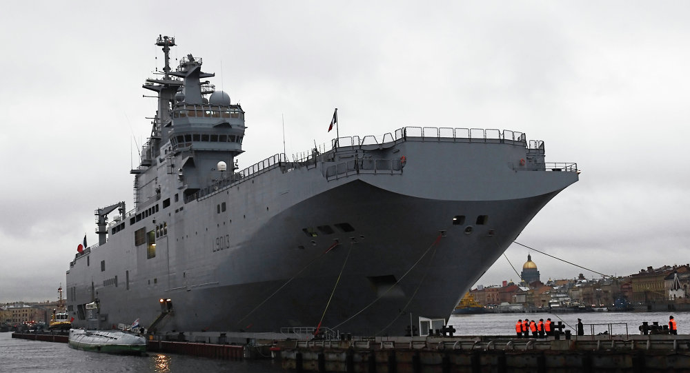 French Mistral-class amphibious assault ship moored near Lieutenant Schmidt Embankment in St. Petersburg