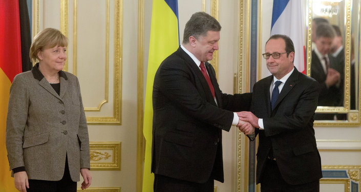 Ukrainian President Petro Poroshenko, center, shakes hands with French President Francois Hollande, right, and German chancellor Angela Merkel during their meeting in Kiev, Ukraine, Thursday, Feb. 5, 2015. The leaders of France and Germany were carrying a new peace initiative to the Ukrainian and Russian capitals Thursday, amid a flurry of high-level diplomacy to end what Hollande called a war on Europe's edge.