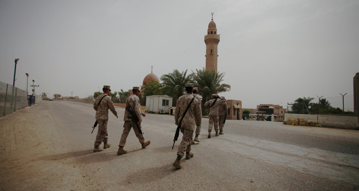 US Marines from Battalion Landing Team, 22nd Marine Expeditionary Unit, walk nearby a mosque in the desert of Jebel Petra, near Aqaba seaport, south of Amman, Jordan. File photo