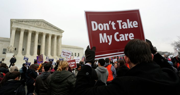 Demonstrators in favor of Obamacare gather at the Supreme Court building in Washington March 4, 2015