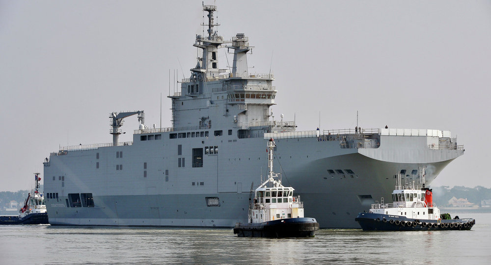 The Sevastopol mistral warship is on its way for its first sea trials, on March 16, 2015 off Saint-Nazaire.