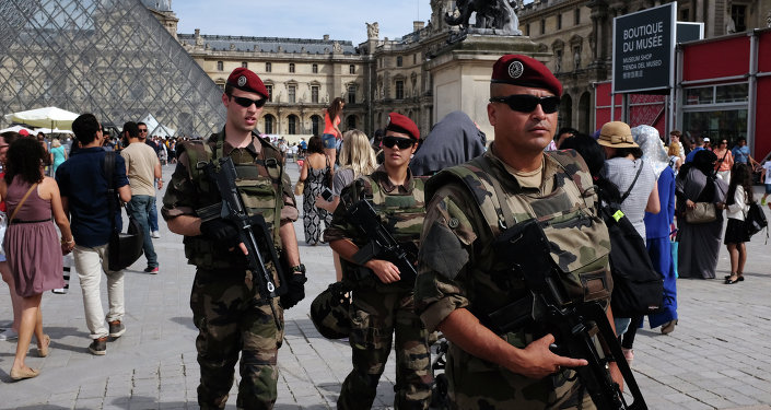 French troops patrol outside the Louvre Museum in Paris on August 5, 2015